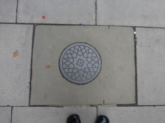 Small manhole covers near Regents Park, London.
