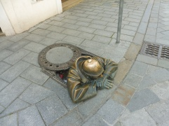 Bratislava's most famous tourist attraction: Cumil the sewer man. Added in 1997 to spice up the drab downtown, Cumil has become wildly popular.